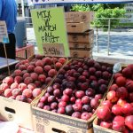 """Fruit at a farmers' market with the caption """"Mix and Match All Fruit $3.49/lb"""""""