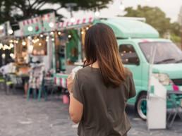 Young woman walking toward a food truck