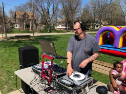 A DJ spins tunes in the park